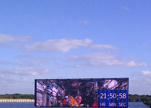 The new NASA Countdown clock was used for the first time on December 1, 2014 for the Orion first launch on December 4, 2014. The new display is very similar in size to the historic countdown clock, with a screen nearly 26 feet wide by 7 feet high. While not true high-definition, the video resolution will be 1280 x 360. This new countdown clock has a wide-screen capability that utilizes the latest breakthroughs in outdoor LED display technology with streaming video available.  (Image courtesy of NASA)