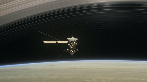 This is an artist's conception of Cassini doing one of its exploratory dives between Saturn and its innermost ring (Image courtesy of NASA)
