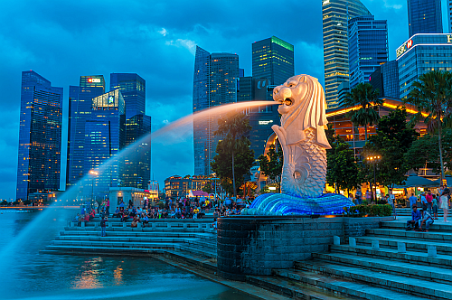 The Merlion fountain lit up at night on December 22, 2013 in Singapore (Image Credit: Vincent St. Thomas/Shutterstock.com.)