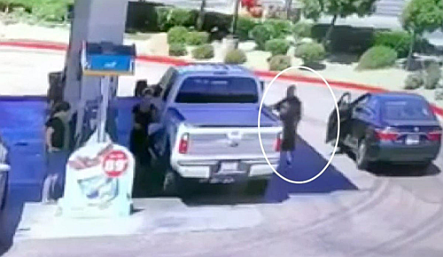 Thief stealing a pocketbook while the victim is pumping gas