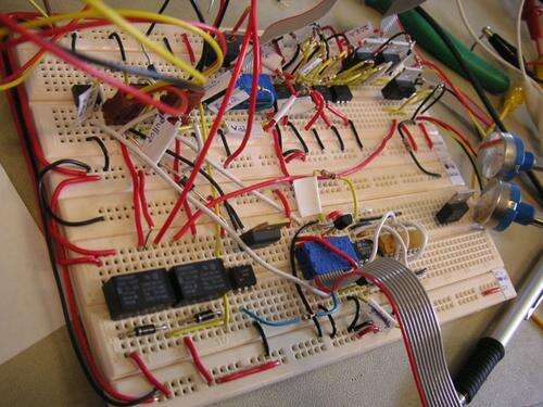 A classic solderless breadboard using DIP ICs and discrete components. (Source: Cornell University)