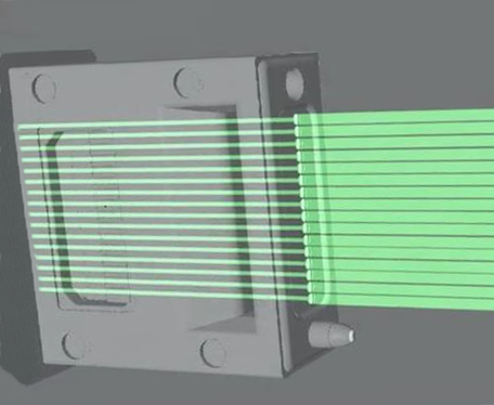 The connector recesses the multi-mode fibers and sends the light through a beam-expanding lens to increase the diameter, shown near the exit edge of the connector body where the light beams grow in diameter. Intel and Corning claim the larger beams offer 10x better immunity to dust particles and eliminate the tolerances required in traditional connectors. They call this arrangement a lensed ferrule.(Source: Intel)