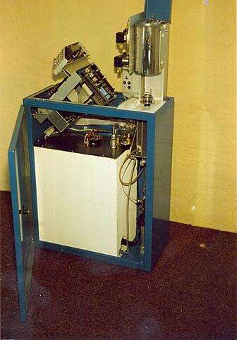 A calorimeter is a device that measures the caloric value of a substance. In this machine, coal is ground to a powder and placed in a ceramic crucible. It is then placed in a sealed container (with a water jacket) in the presence of oxygen. The coal dust is ignited, and the resulting combustion warms the water. This calorimeter measures the temperature rise of the water using a string of diodes. The control was realized with an Intel iSBC80/10B single-board computer (based around the i8080) and an external 12-bit ADC.