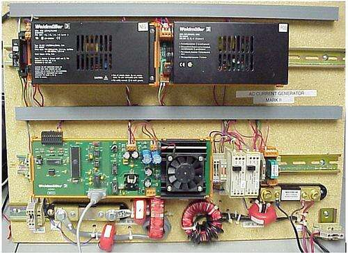 Here is the original system. Because this unit was to be used on multiple products we created two transformers. The 10A is on the lower right with the black secondary winding. To its left, seen mounted vertically, is the 100A transformer with a car battery lead as the secondary. The other three pink/red toroids are current transformers used to measure the current as part of the closed loop control. The shunt resistors you can see are used for unit calibration.