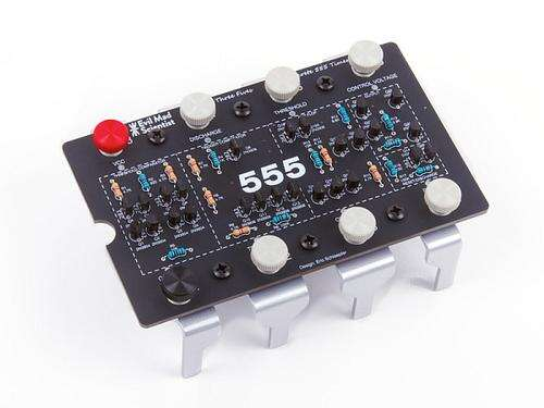 The 'Three Fives' kit from Evil Mad Scientist is an all-discrete version of the classic 555 timer IC, and allows full access to all the internal waveforms; it's a great tool for insight and understanding.