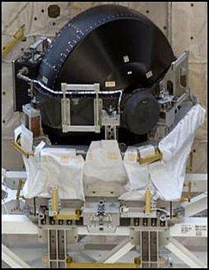 A new Control Moment Gyroscope sits in its cradle in the payload bay of the Space Shuttle Discovery prior to its installation on the International Space Station in 2005, to replace one which failed in 2002; the International Space Station has three of the 600-pound (272 kg) gyroscopes controlling its attitude (photo courtesy NASA).
