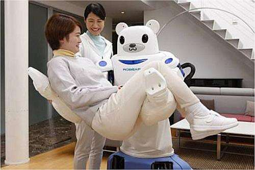 The ROBEAR robot in action carrying a person (Source: riken.jp)