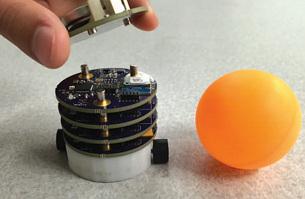 About the size of a 40 mm diameter tennis ball, this two-wheel mobile robot is made up of magnetic contact modules consisting of power, communication (Bluetooth is typically used), mobility, and two input (barometer and IMU) modules (Image courtesy of Reference 2)