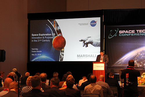 Todd May in front of a full audience at the Space Tech Expo giving his Keynote address (Image courtesy of Loretta Taranovich)