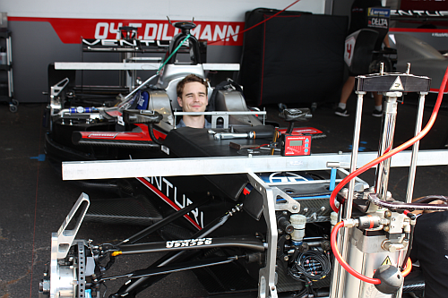 Venturi Race Team driver, Tom Dillmann, in one of the two Venturi electric race cars two days before the race. As can be seen in this image, the car is only partially assembled at this point in the Paddock. It only takes two hours to fully assemble the car for the race after removing from the transport vehicle. (Image courtesy of Loretta Taranovich)